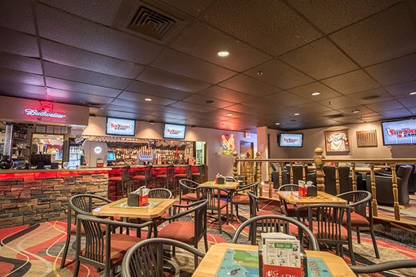Splitz Bar and grill dining area with tables and TVs