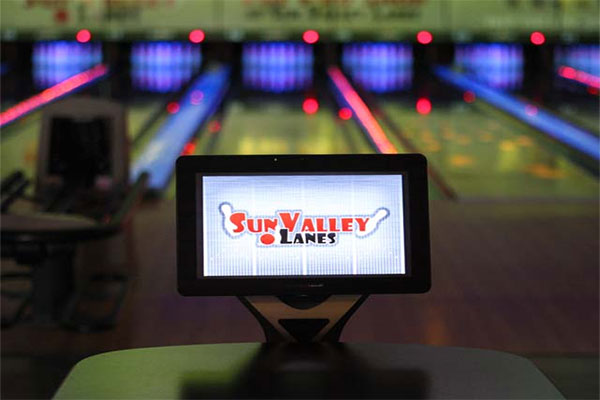 Close up of the touching screen on a bowling lane, with the Sun Valley Lanes logo on the screen